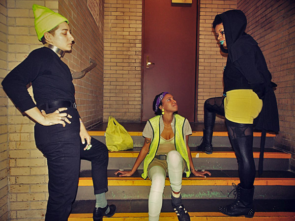 three of the metropolarity crew members pose on a small set of steps in a hallway