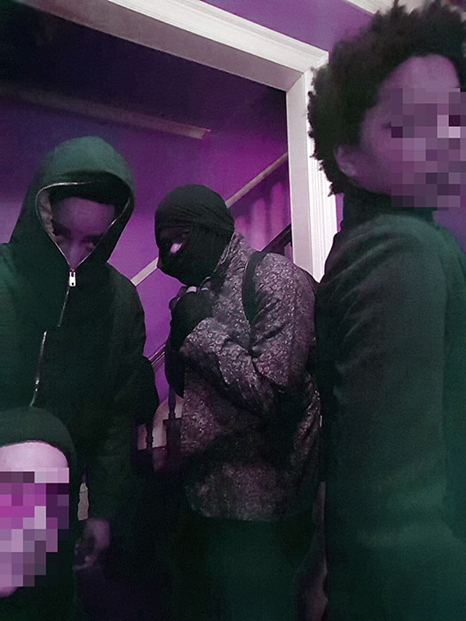 the crew with blurred out and covered faces