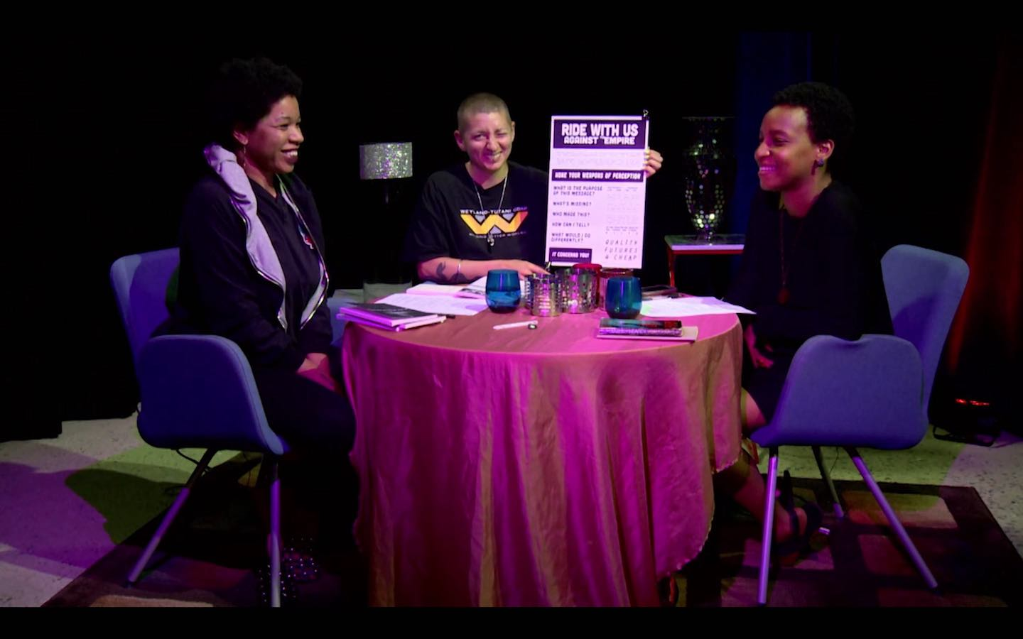 Rasheedah, Monk, and Ras sitting around a table on PhillyCAM's singular Soothsaying with Metropolarity